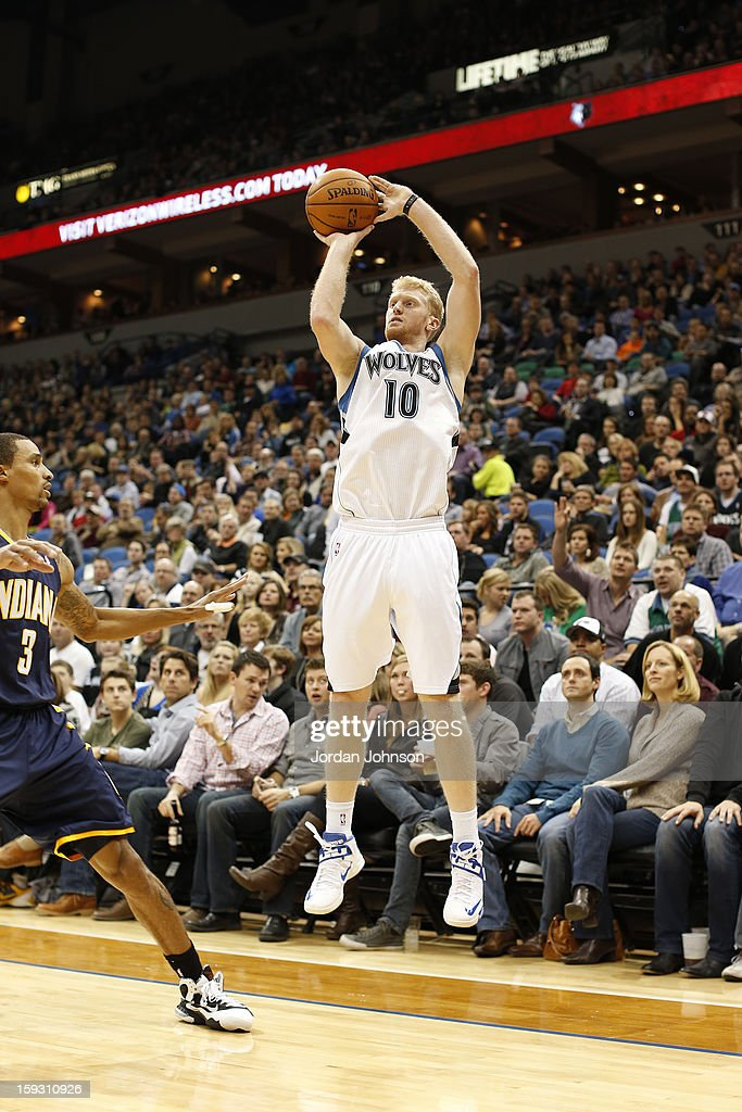Chase Budinger #10 of the Minnesota Timberwolves shoots against George Hill #3 of the Indiana Pacers on November 9, 2012 at Target Center in Minneapolis, Minnesota.