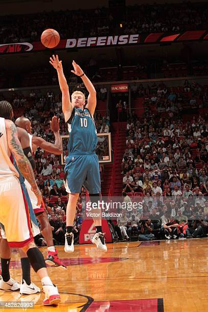 Chase Budinger of the Minnesota Timberwolves shoots the ball against the Miami Heat at the American Airlines Arena in Miami Florida on April 4 2014...