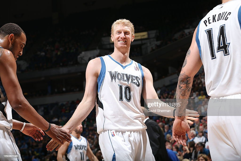 <a gi-track='captionPersonalityLinkClicked' href=/galleries/search?phrase=Chase+Budinger&family=editorial&specificpeople=3847600 ng-click='$event.stopPropagation()'>Chase Budinger</a> #10 of the Minnesota Timberwolves smiles and slaps fives against the Detroit Pistons during the game on April 6, 2013 at Target Center in Minneapolis, Minnesota.