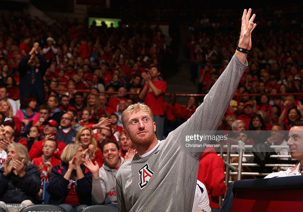 <a gi-track='captionPersonalityLinkClicked' href=/galleries/search?phrase=Chase+Budinger&family=editorial&specificpeople=3847600 ng-click='$event.stopPropagation()'>Chase Budinger</a> of the Minnesota Timberwolves waves to fans as he attends the college basketball game between the Arizona Wildcats and the Florida Gators at McKale Center on December 15, 2012 in Tucson, Arizona. The Wildcats defeated the Gators 65-64.