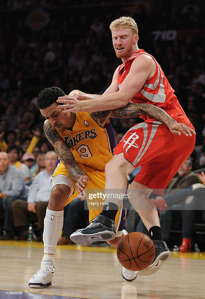 Chase Bundinger #10 of the Houston Rockets is fouled by <a gi-track='captionPersonalityLinkClicked' href=/galleries/search?phrase=Matt+Barnes+-+Basketball+Player&family=editorial&specificpeople=202880 ng-click='$event.stopPropagation()'>Matt Barnes</a> #9 of the Los Angeles Lakers during a 112-107 Rocket win at Staples Center on April 6, 2012 in Los Angeles, California.