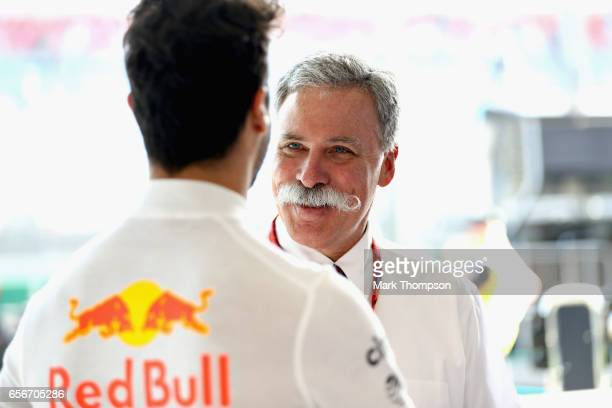Chase Carey CEO and Executive Chairman of the Formula One Group and Daniel Ricciardo of Australia and Red Bull Racing talk in the Red Bull Racing...