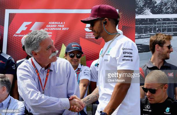 Chase Carey CEO and Executive Chairman of the Formula One Group shakes hands with Lewis Hamilton of Great Britain and Mercedes GP before the Canadian...