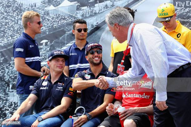 Chase Carey CEO and Executive Chairman of the Formula One Group shakes hands with Daniel Ricciardo of Australia and Red Bull Racing before the...