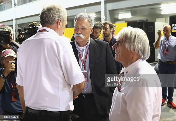 Chase Carey Chairman of Formula One Group talks with F1 supremo Bernie Ecclestone and Red Bull Racing Team Consultant Dr Helmut Marko in the Paddock...