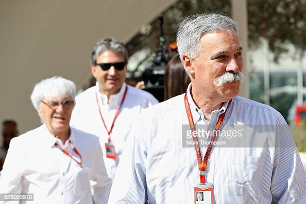 Chase Carey Chairman of Formula One Group walks in the Paddock ahead of F1 supremo Bernie Ecclestone and Pasquale Lattuneddu of FOM before the Abu...