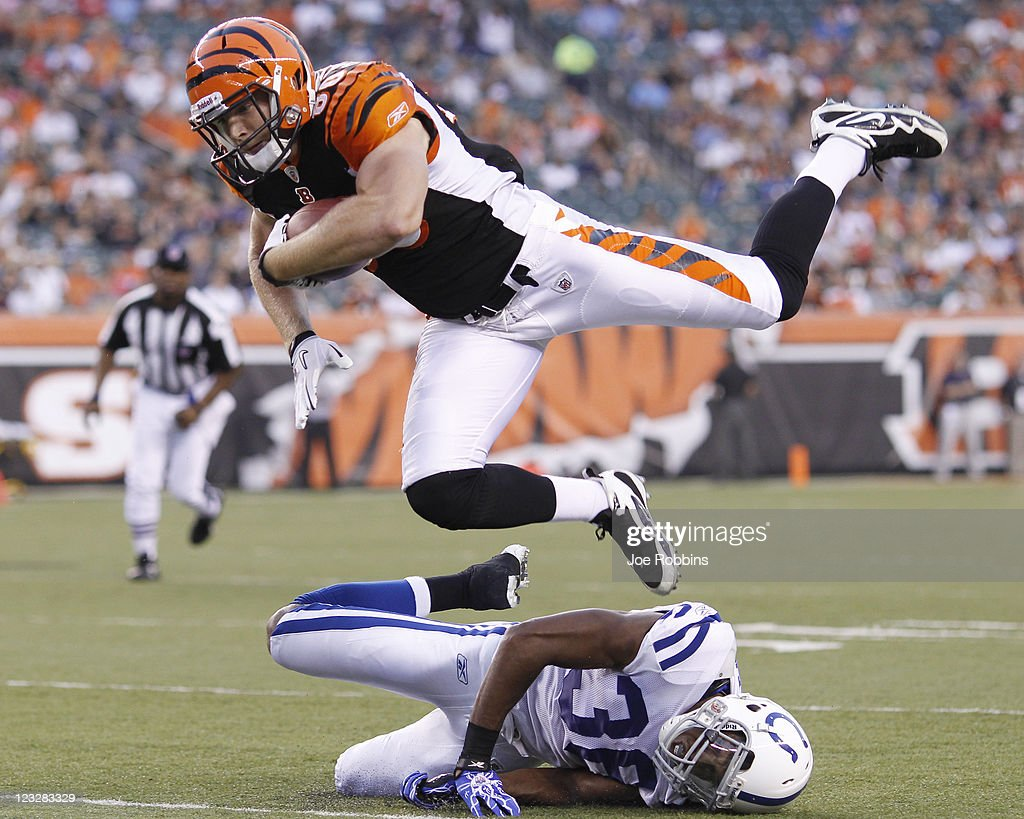 Chase Coffman #80 of the Cincinnati Bengals jumps for a first down over Chris Rucker #36 of the Indianapolis Colts in the first half of an NFL preseason game at Paul Brown Stadium on September 1, 2011 in Cincinnati, Ohio.