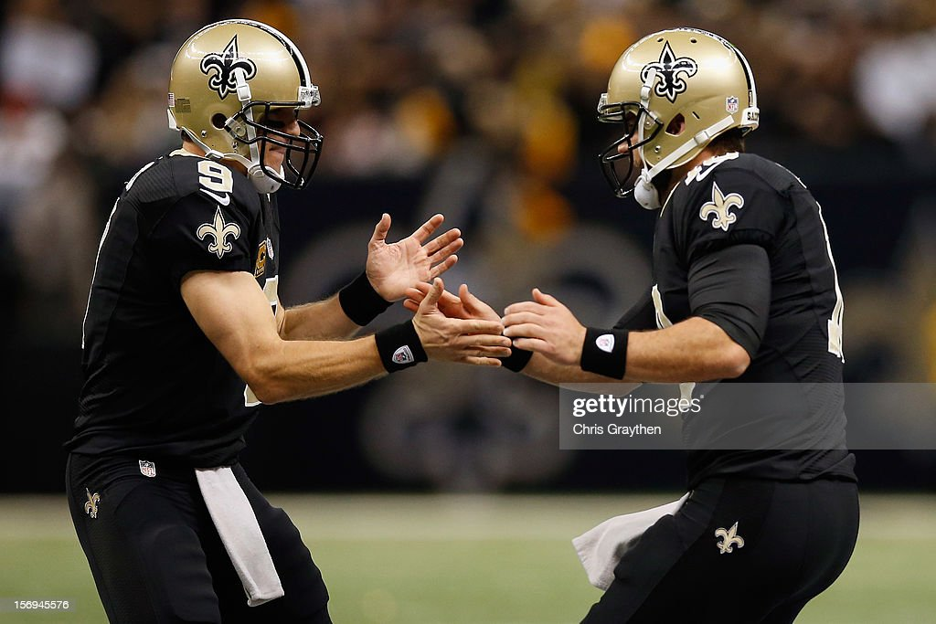 Chase Daniel #10 and Drew Brees #9 of the New Orleans Saints celebrate after a touchdown against the San Francisco 49ers at The Mercedes-Benz Superdome on November 25, 2012 in New Orleans, Louisiana.