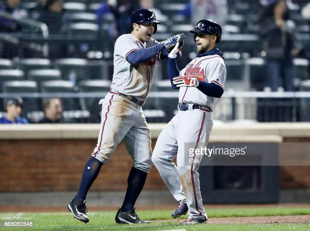 Chase d'Arnaud and Ender Inciarte of the Atlanta Braves celebrate after they scored in the 12th inning against the New York Mets on a double from...