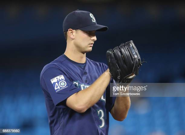 Chase De Jong of the Seattle Mariners looks in before delivering a pitch in the first inning during MLB game action against the Toronto Blue Jays at...