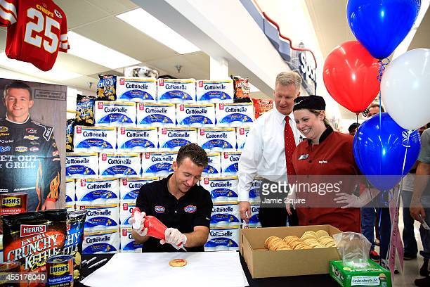 Chase Driver AJ Allmendinger decorates cookies while making an appearance at a HyVee grocery store on September 10 2014 in Shawnee Kansas