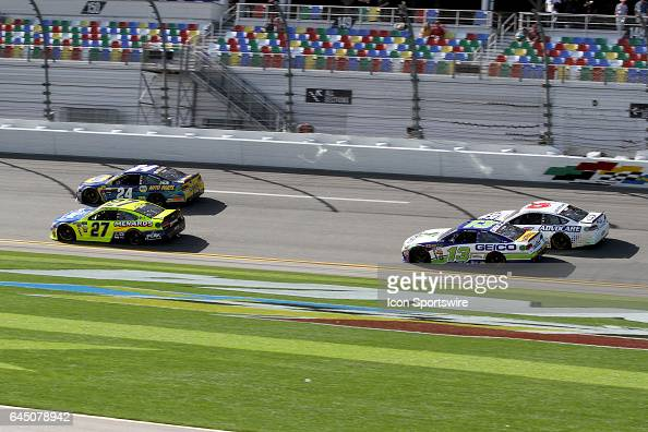 Chase Elliott and Paul Menard lead Ty Dillon and Trevor Bayne through the front stretch during practice for the NASCAR Monster Energy Cup Series...