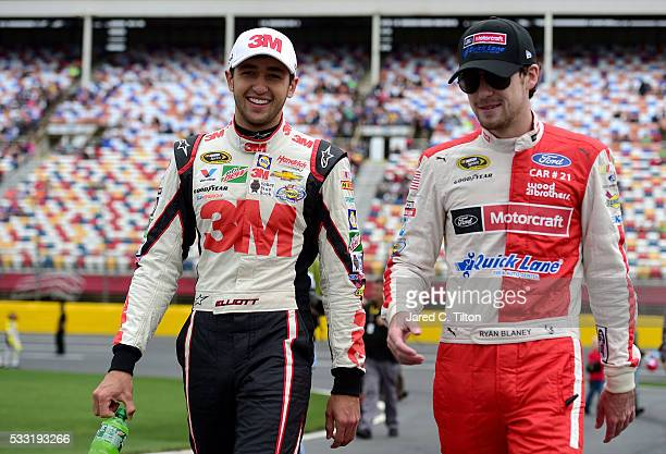 Chase Elliott driver of the 3M Chevrolet and Ryan Blaney driver of the Motorcraft/Quick Lane Tire Auto Center Ford walk on the grid during the NASCAR...