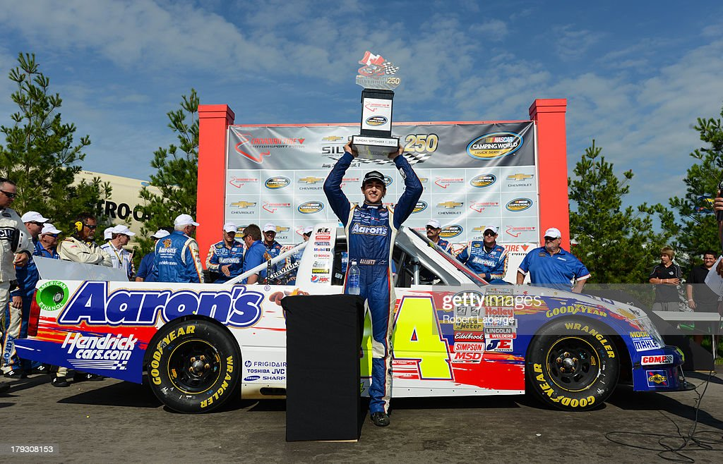 Chase Elliott, driver of the #94 Aaron's Dream Machine Chevrolet celebrates after winning the NASCAR Camping World Truck Series Chevrolet Silverado 250 at the Canadian Tire Motorsports Park on September 1, 2013 in Bowmanville, Ontario, Canada.