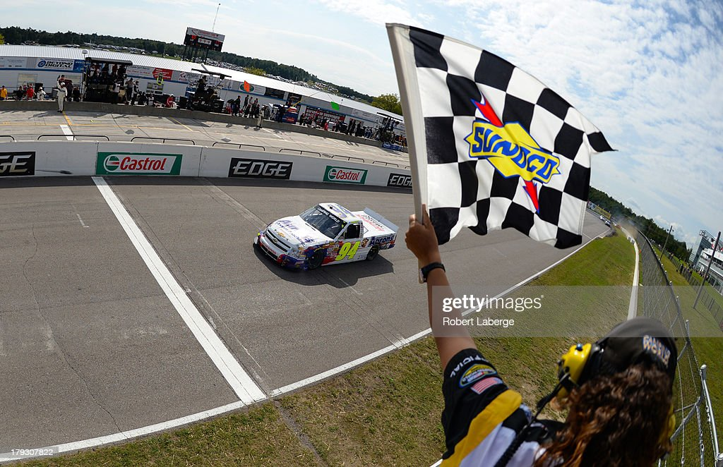 Chase Elliott, driver of the #94 Aaron's Dream Machine Chevrolet, crosses the finish line after spinning out <a gi-track='captionPersonalityLinkClicked' href=/galleries/search?phrase=Ty+Dillon&family=editorial&specificpeople=6312493 ng-click='$event.stopPropagation()'>Ty Dillon</a>, driver of the #3 Bass Pro Shops Tracker Boats Chevrolet, to win the NASCAR Camping World Truck Series Chevrolet Silverado 250 at the Canadian Tire Motorsports Park on September 1, 2013 in Bowmanville, Ontario, Canada.