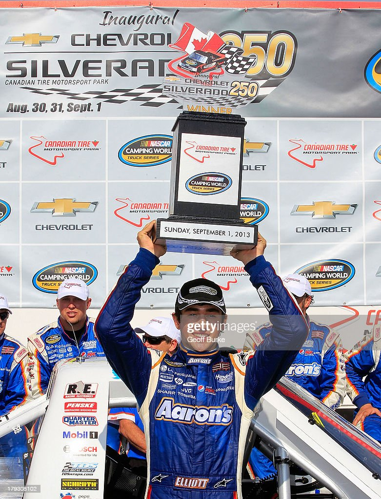 Chase Elliott, driver of the #94 Aaron's Dream Machine/Hendrickcars.com Chevrolet, celebrates in victory lane after winning the NASCAR Camping World Truck Series Chevrolet Silverado 250 at Canadian Tire Motorsport Park on September 1, 2013 in Bowmanville, Canada.