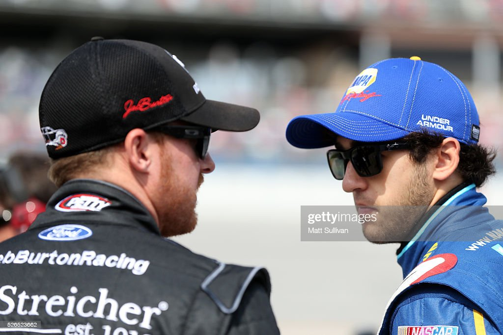 Chase Elliott, driver of the #88 Armour Vienna Sausage Chevrolet, talks to Jeb Burton, driver of the #43 J. Streicher Ford, on the grid during qualifying for the NASCAR XFINITY Series Sparks Energy 300 at Talladega Superspeedway on April 30, 2016 in Talladega, Alabama.