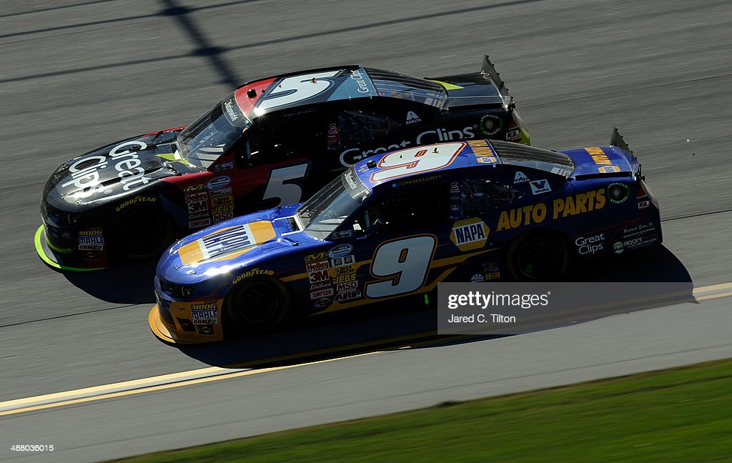 Chase Elliott driver of the NAPA Auto Parts Chevrolet and Kasey Kahne driver of the Great Clips Chevrolet race during the NASCAR Nationwide Series...