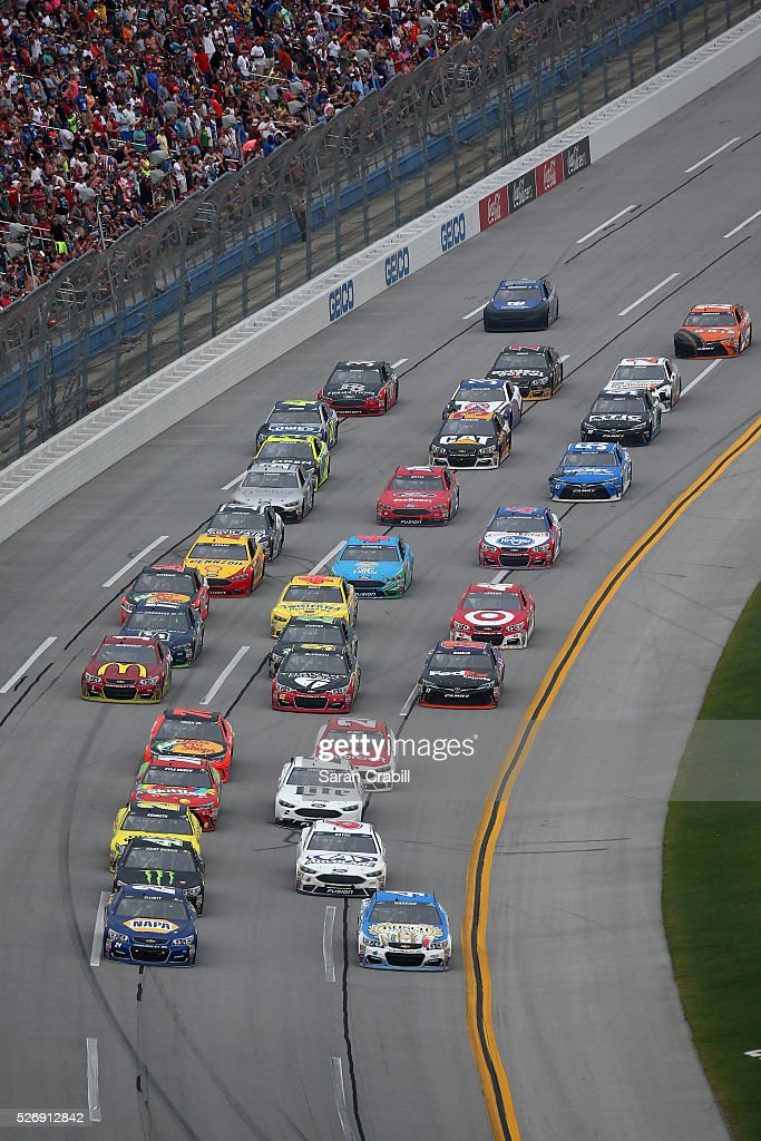 Chase Elliott, driver of the #24 NAPA Auto Parts Chevrolet, and Kevin Harvick, driver of the #4 Busch Fishing Chevrolet, lead a pack of cars during the NASCAR Sprint Cup Series GEICO 500 at Talladega Superspeedway on May 1, 2016 in Talladega, Alabama.