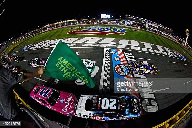 Chase Elliott driver of the NAPA Auto Parts Chevrolet and Matt Kenseth driver of the GameStop Toyota lead the field to the green flag for the running...