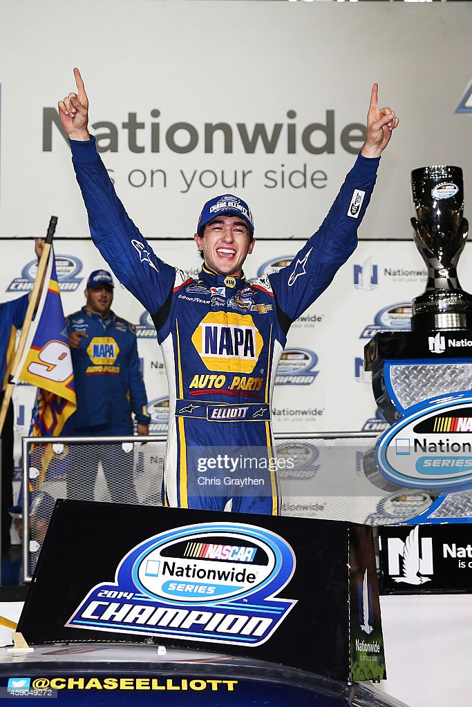 Chase Elliott, driver of the #9 NAPA Auto Parts Chevrolet, celebrates in Victory Lane after winning the series championship during the NASCAR Nationwide Series Ford EcoBoost 300 at Homestead-Miami Speedway on November 15, 2014 in Homestead, Florida.