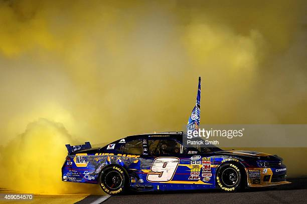 Chase Elliott driver of the NAPA Auto Parts Chevrolet celebrates winning the series championship with a burnout during the NASCAR Nationwide Series...