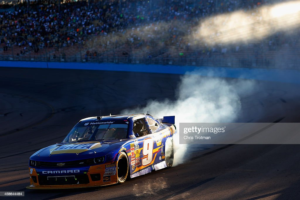 Chase Elliott driver of the NAPA Auto Parts Chevrolet celebrates with a burnout after winning the NASCAR Nationwide Series Championship following his...