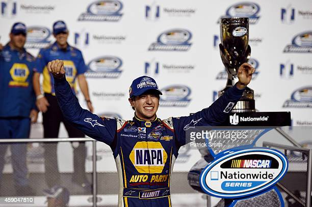 Chase Elliott driver of the NAPA Auto Parts Chevrolet celebrates with the trophy in Victory Lane after winning the series championship after the...
