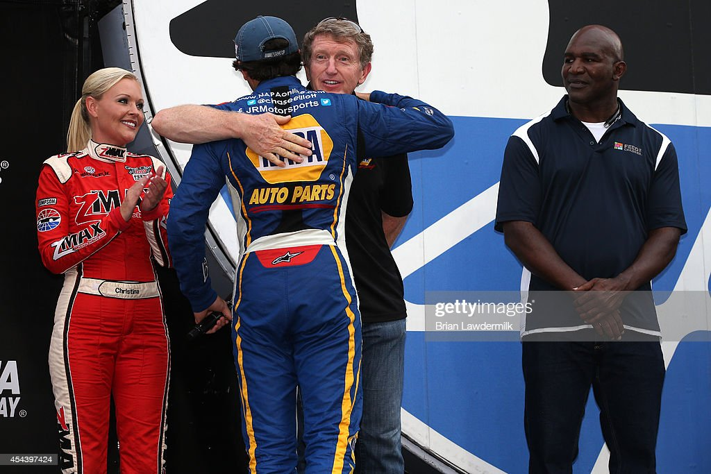 Chase Elliott, driver of the #9 NAPA AUTO PARTS Chevrolet, hugs his dad, NASCAR Hall of Famer Bill Elliott, after being introduced prior to the NASCAR Nationwide Series Great Clips 300 at Atlanta Motor Speedway on August 30, 2014 in Hampton, Georgia.