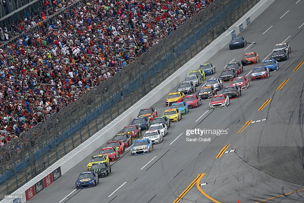 Chase Elliott, driver of the #24 NAPA Auto Parts Chevrolet, leads a pack of cars during the NASCAR Sprint Cup Series GEICO 500 at Talladega Superspeedway on May 1, 2016 in Talladega, Alabama.