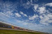 Chase Elliott driver of the NAPA Auto Parts Chevrolet leads the field to start the NASCAR Sprint Cup Series DAYTONA 500 at Daytona International...