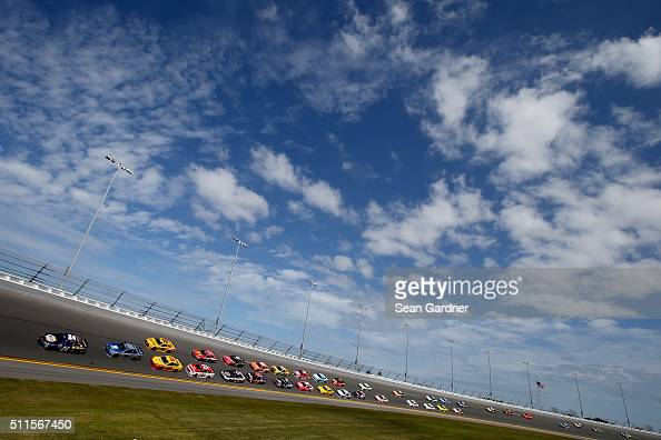 Chase Elliott driver of the NAPA Auto Parts Chevrolet leads the field to start the NASCAR Sprint Cup Series DAYTONA 500 at Daytona International...