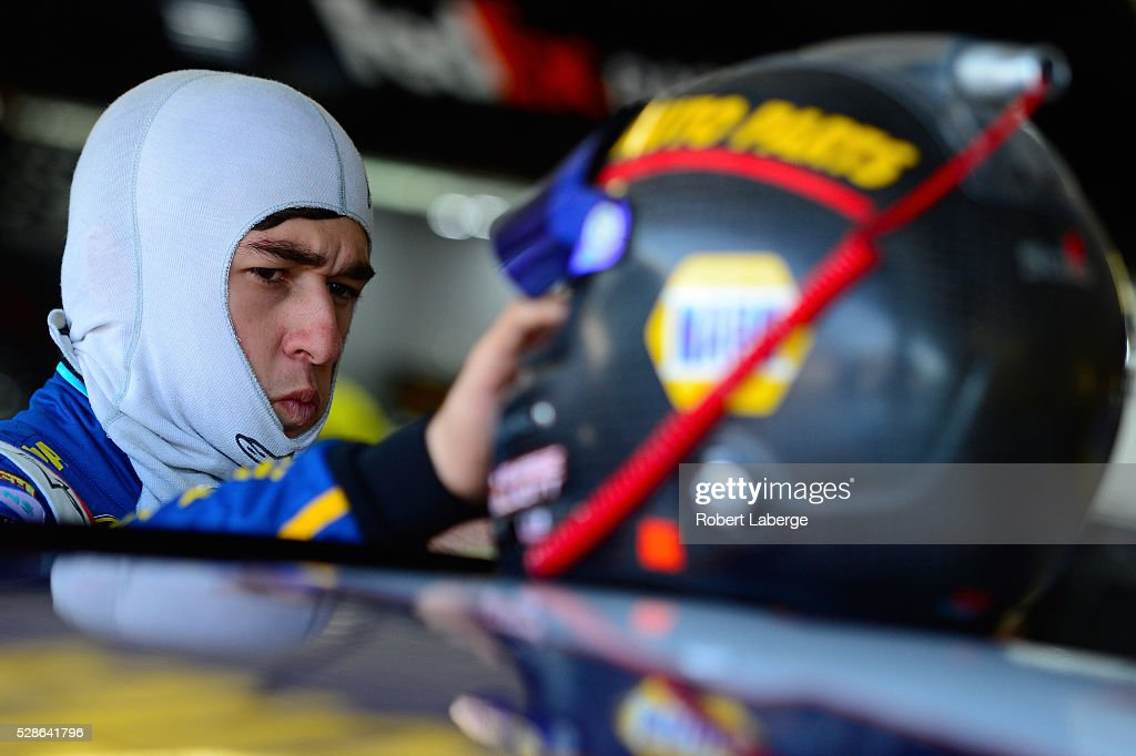 Chase Elliott, driver of the #24 NAPA Auto Parts Chevrolet, looks on during practice for the NASCAR Sprint Cup Series Go Bowling 400 at Kansas Speedway on May 6, 2016 in Kansas City, Kansas.