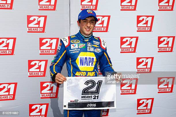 Chase Elliott driver of the NAPA Auto Parts Chevrolet poses with the 21 Means 21 Pole Award after qualifying for pole position in the NASCAR Sprint...