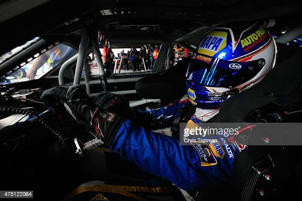 Chase Elliott driver of the NAPA Auto Parts Chevrolet prepares his gloves in the garage area during practice for the NASCAR XFINITY Series Buckle Up...