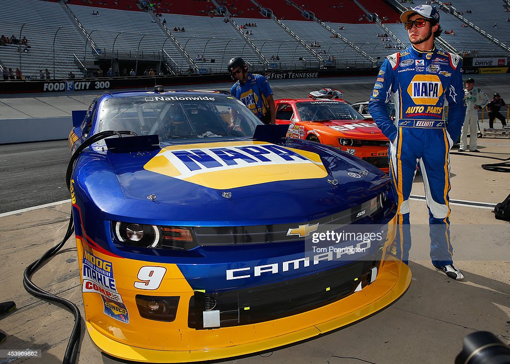 Chase Elliott, driver of the #9 NAPA Auto Parts Chevrolet, stands beside his car on pit road during qualifying for the NASCAR Nationwide Series Food City 300 at Bristol Motor Speedway on August 22, 2014 in Bristol, Tennessee.