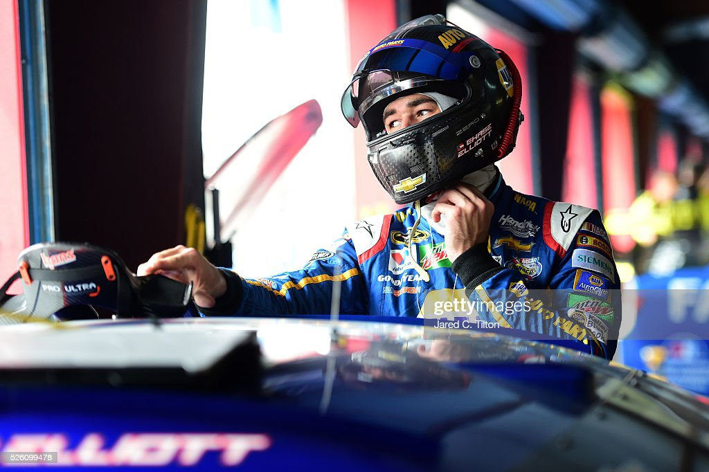 <a gi-track='captionPersonalityLinkClicked' href=/galleries/search?phrase=Chase+Elliott&family=editorial&specificpeople=3623017 ng-click='$event.stopPropagation()'>Chase Elliott</a>, driver of the #24 NAPA Auto Parts Chevrolet, stands in the garage area during practice for the NASCAR Sprint Cup Series GEICO 500 at Talladega Superspeedway on April 29, 2016 in Talladega, Alabama.
