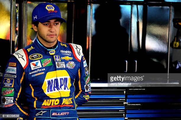 Chase Elliott driver of the NAPA Auto Parts Chevrolet stands in the garage area during practice for the NASCAR Sprint Cup Series Goody's Fast Relief...