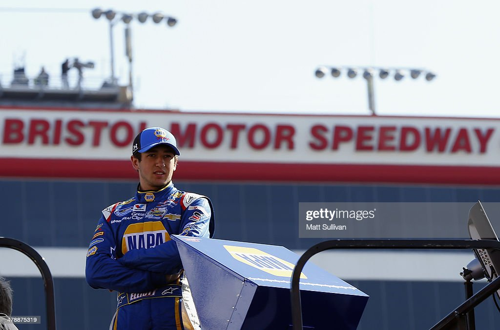 Chase Elliott, driver of the #9 NAPA AUTO PARTS Chevrolet, stands on top of a hauler during qualifying for the NASCAR Nationwide Series Drive To Stop Diabetes 300 at Bristol Motor Speedway on March 15, 2014 in Bristol, Tennessee.