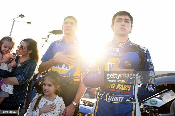 Chase Elliott driver of the NAPA Auto Parts Chevrolet takes part in prerace ceremonies for the NASCAR Nationwide Series Ford EcoBoost 300 at...