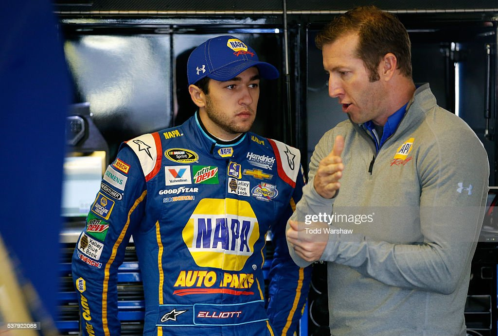 Chase Elliott driver of the NAPA Auto Parts Chevrolet talks with crew chief Alan Gustafson during practice for the NASCAR Sprint Cup Series Axalta...