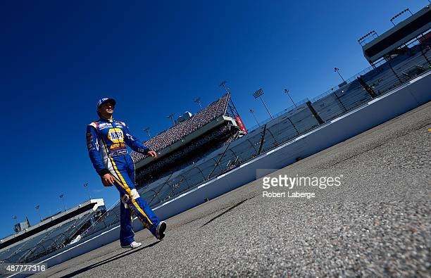 Chase Elliott driver of the NAPA Auto Parts Chevrolet walks down pit road prior to qualifying for the NASCAR XFINITY Series Virginia529 College...