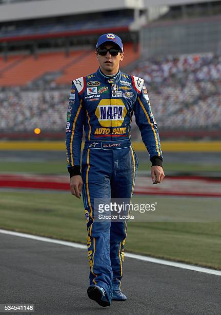 Chase Elliott driver of the NAPA Auto Parts Chevrolet walks down pit road during qualifying for the NASCAR Sprint Cup Series CocaCola 600 at...