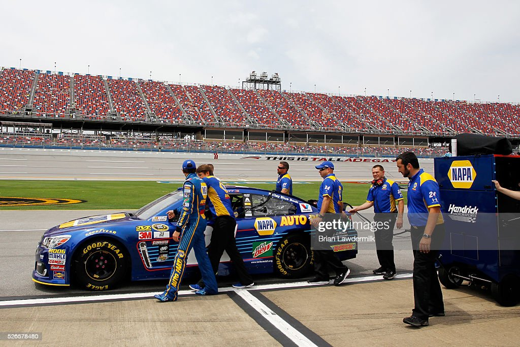 Chase Elliott, driver of the #24 NAPA Auto Parts Chevrolet, walks on the grid during qualifying for the NASCAR Sprint Cup Series GEICO 500 at Talladega Superspeedway on April 30, 2016 in Talladega, Alabama.