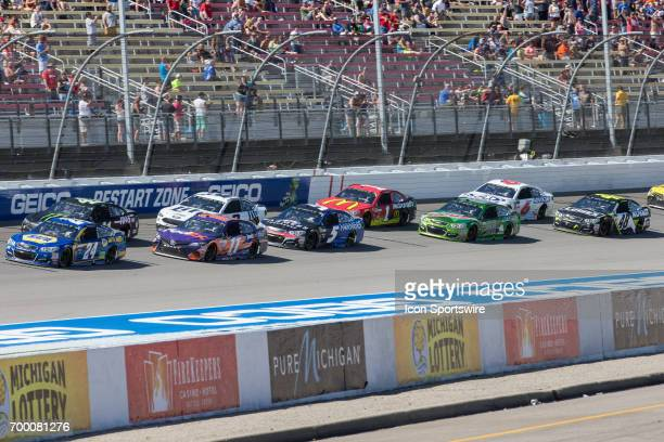Chase Elliott driver of the NAPA Chevrolet and Denny Hamlin driver of the FedEx Office Toyota lead the pack during the Monster Energy Cup Series...