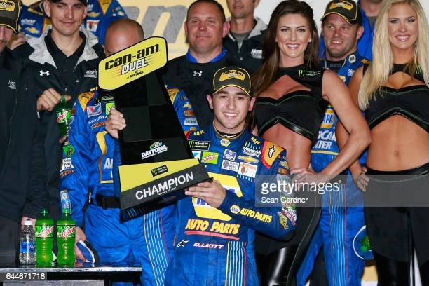Chase Elliott driver of the NAPA Chevrolet celebrates with the trophy in Victory Lane after winning the Monster Energy NASCAR Cup Series CanAm Duel 1...