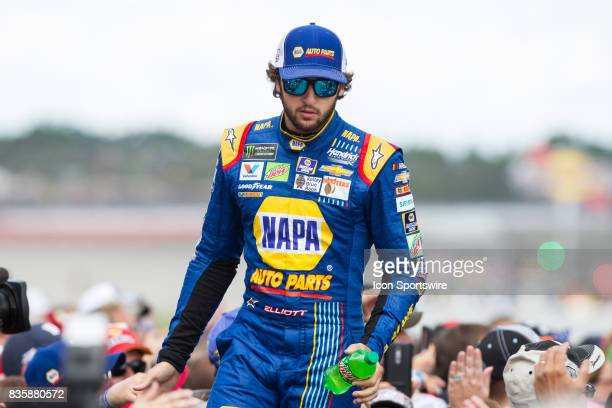 Chase Elliott driver of the NAPA Chevrolet greets fans during the prerace ceremonies of the Monster Energy NASCAR Cup Series Pure Michigan 400 race...