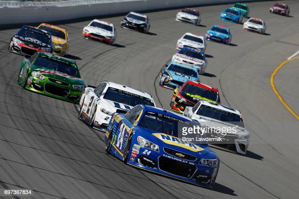Chase Elliott driver of the NAPA Chevrolet leads a pack of cars during the Monster Energy NASCAR Cup Series FireKeepers Casino 400 at Michigan...