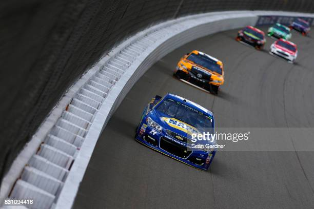 Chase Elliott driver of the NAPA Chevrolet leads a pack of cars during the Monster Energy NASCAR Cup Series Pure Michigan 400 at Michigan...