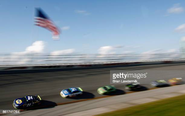 Chase Elliott driver of the NAPA Chevrolet leads a pack of cars during the Monster Energy NASCAR Cup Series Alabama 500 at Talladega Superspeedway on...